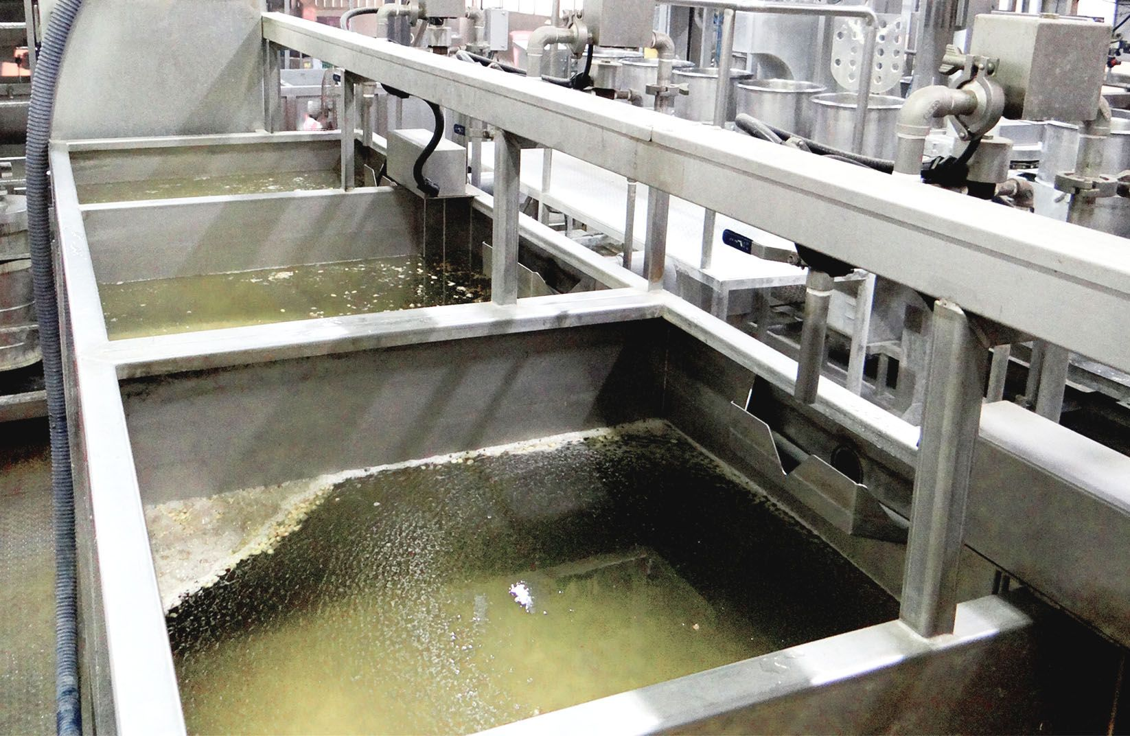 While the water put into soaking tank, some of bad soybeans and impurities will float on the water.